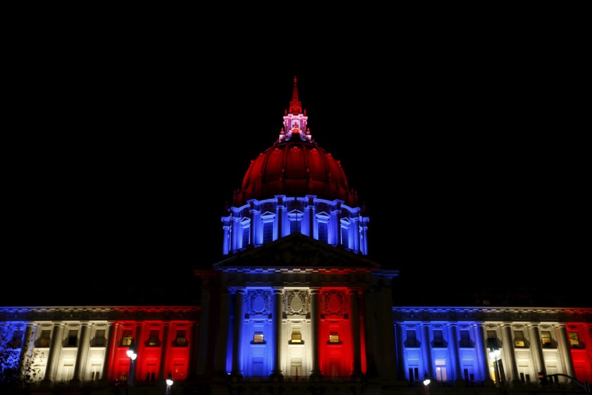 San Francisco City Hall is lit up with blue, white and red, the colors of the French flag, following the Paris terror attacks, in San Francisco, California November 13, 2015. REUTERS/Stephen Lam