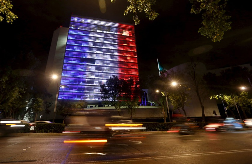 The Senate building is lit up in blue, white and red, the colors of the French flag, following the Paris terror attacks, in Mexico City, November 14, 2015. REUTERS/Tomas Bravo