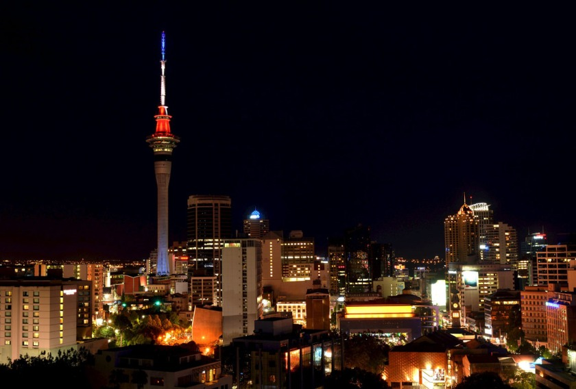 Auckland's Sky Tower is lit in the blue, white and red colors of the French flag in honour of the victims of the attacks in Paris, in Auckland, New Zealand, November 14, 2015.    REUTERS/Rafael Ben-Ari        EDITORIAL USE ONLY. NO RESALES. NO ARCHIVE