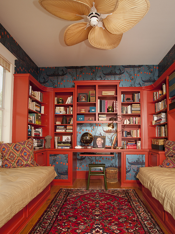 As seen on HGTV's Celebrities at Home, the study in Shawn Colvin's home is decorated with deep, reds and blues.  There is a strong Asian influence in this room, including the wall paper, rug, and ceiling fan.